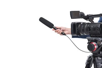 Kamera i mikrofon podczas wywiadu z coachem